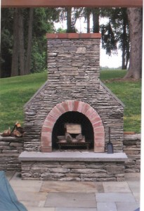 Fieldstone-fireplace-with-bluestone-hearth