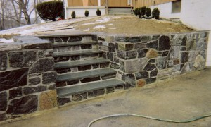 Granite-wall-with-bluestone-steps