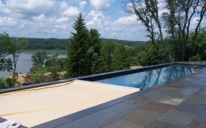 Repeating-pattern-natural-cleft-bluestone-pool-patio-with-thermal-bluestone-coping