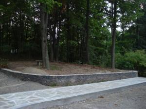 Mosaic-pattern-natural-cleft-bluestone-walkway-with-tumbled-bluestone-border-NY-bluestone-wall